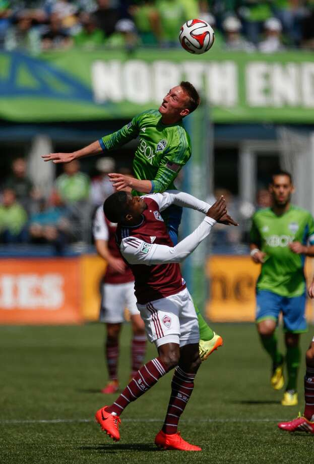 SEATTLE, WA - APRIL 26: Dylan Remick #15 of the Seattle Sounders FC battles Edson Buddle #9 of the Colorado Rapids at CenturyLink Field on April 26, 2014 in Seattle, Washington. (Photo by Otto Greule Jr/Getty Images) Photo: Otto Greule Jr/Getty Images