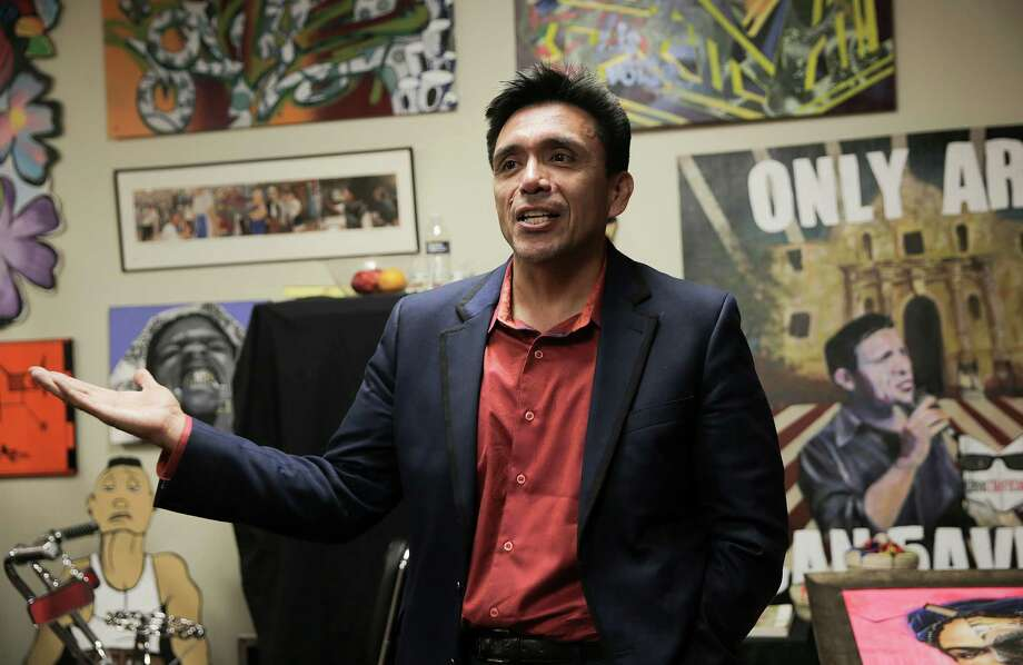 Tony Diaz, the director of Nuestra Palabra, talks about the new nonprofit bookstore located inside the Talento Bilengue de Houston cultural arts and education center. Photo: Elizabeth Conley, Houston Chronicle / © 2016 Houston Chronicle