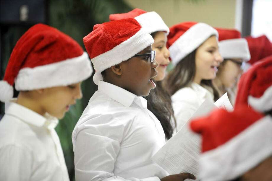 FILE — The K.T. Murphy Elementary School fifth grade Chamber Choir sings holiday songs with the residents of Atria on Friday, Dec. 18, 2015. Photo: Michael Cummo / Hearst Connecticut Media / Stamford Advocate