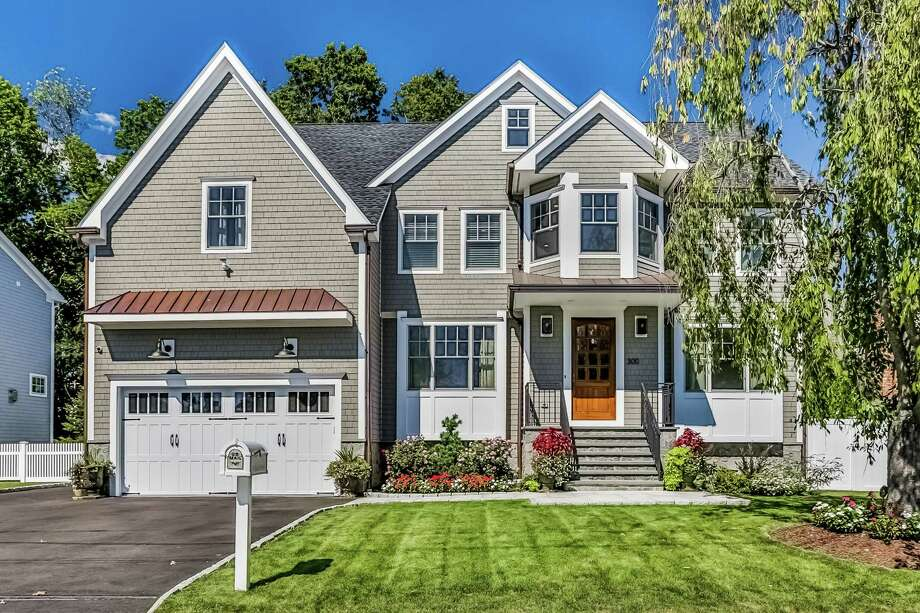 The gray cedar shingle colonial at 300 Quincy Street, which was built in 2015 by Fairfield contractor Bella Homes is chock full of amenities and is only two blocks from Long Island Sound. Photo: Contributed Photos / © 2015 PlanOmatic