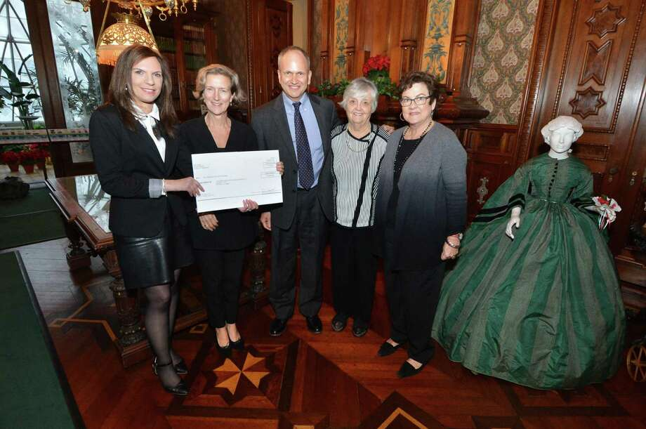 Lockwood-Mathews Mansion Museum Executive Director Susan Gilgore accepts a check for $10,000 from Global Communications Vice President Elanor Mascheroni and Corporate Citizenship Leader William Adler of GE, with Lockwood-Mathews Chairman of the Board Patsy Brescia and Trustee Gail Candlin. The funds will be put towards the museum's education fund. Photo: Alex Von Kleydorff / Hearst Connecticut Media / Connecticut Post