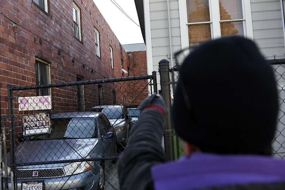 Jonah Strauss points to windows that still show fire damage at the West Oakland arts hub, live-work space and home of anarchist bookseller AK Press that caught fire in March 2015, killing 2 people and forcing all of it's residents out, in Oakland, CA, on Friday, December 16, 2016. Photo: Michael Short, Special To The Chronicle
