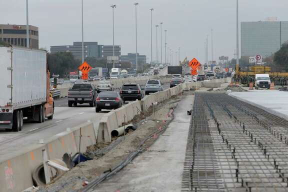 Worker prepare the new westbound main lanes of U.S. 290 near Hollister on Dec. 13 in Houston. Traffic is tentatively scheduled to shift onto the new lanes on Dec. 21 from 34th to Hollister.