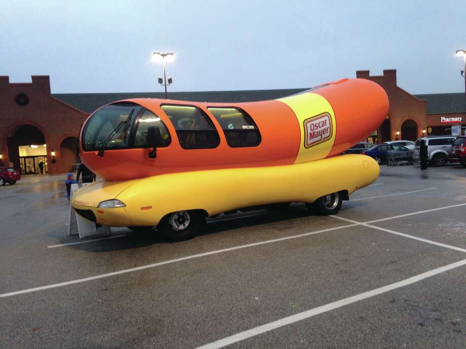 The world famous Oscar Meyer Wienermobile stopped by Friday at Dierbergs in Edwardsville. Visitors braving the elements were offered a peek inside the vehicle and received famous Oscar Mayer whistles. Photo: Kirsten Tucker
