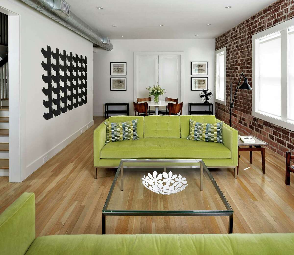 The Dentler building's first floor, western side originally had walls and doors separating it into smaller spaces for an apartment. Now it's a roomy casual living room.