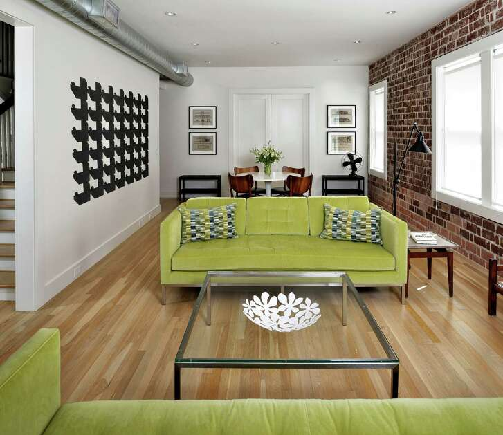 The Dentler building's first floor, western side originally had walls and doors separating it into smaller spaces for an apartment. After, it's a roomy casual living room.