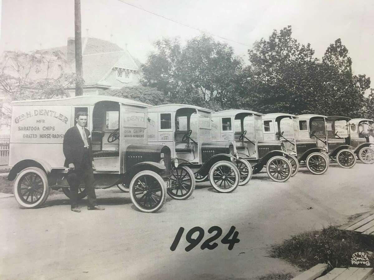 George H. Dentler is shown in 1924 with a row of his potato chip delivery trucks. Dentler Maid Potato Chips were sold in stores and directly to consumers from 1910 to 1962.