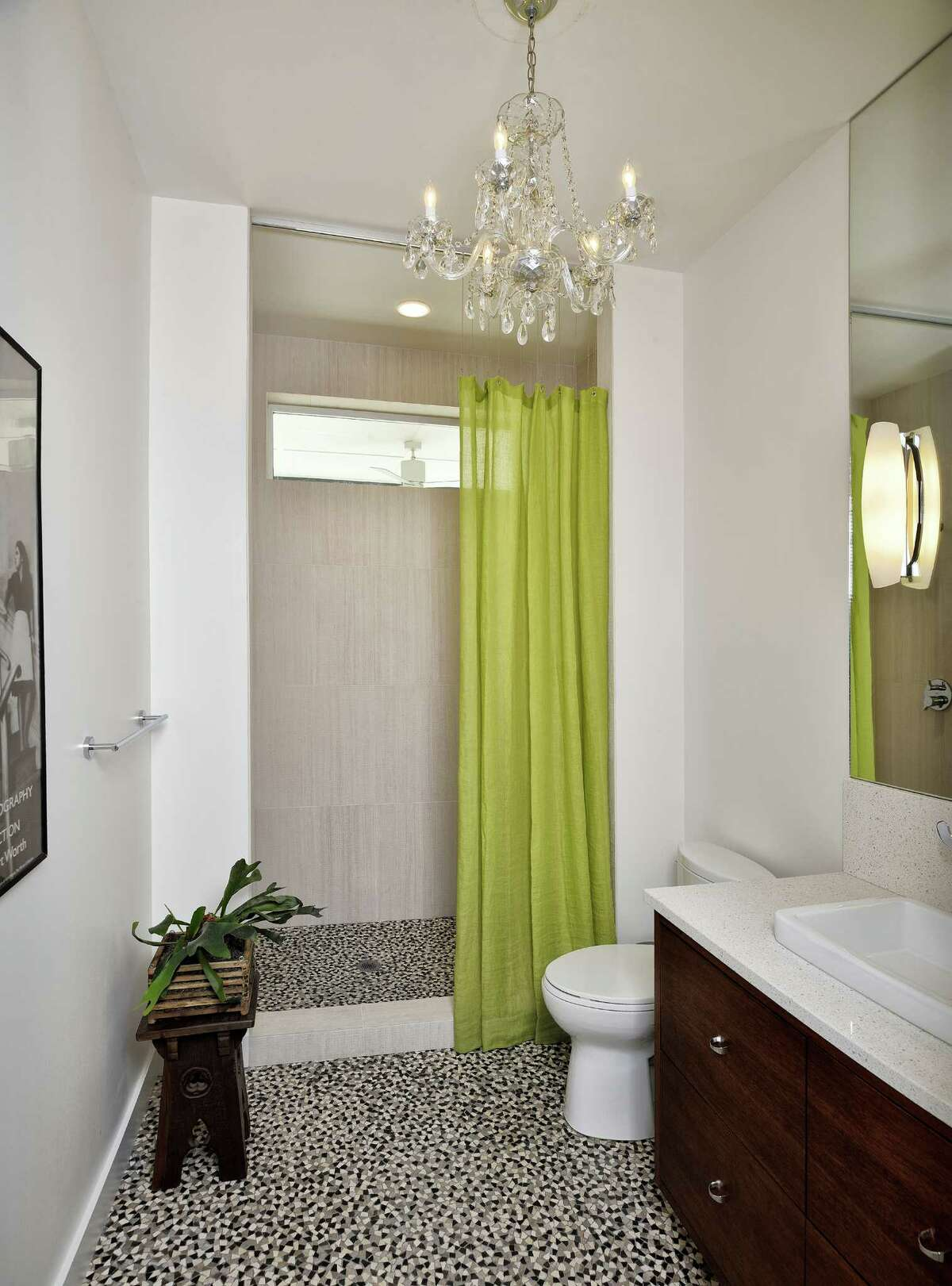 This guest bath wows with its high ceilings, mosaic tile flooring and sparkling chandelier. Its designer was Laura Michaelides of Four Square Design Studio. Full story here.