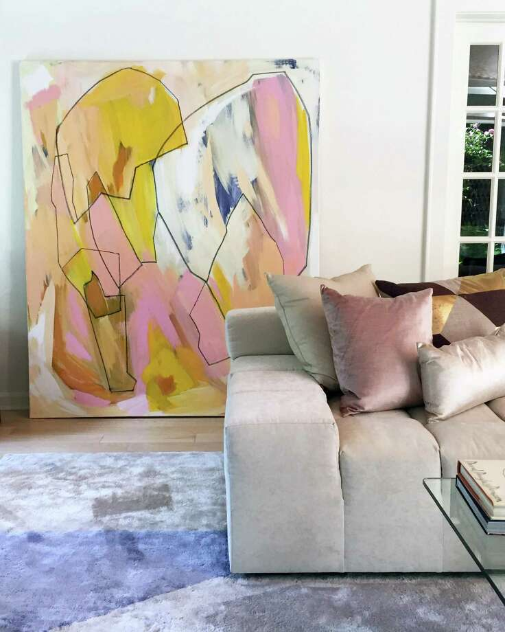 """Painter Linda Colletta is artistic director of D2 Interieurs of Weston, working on a line of textile and wallpaper designs and advising on home art curation. Against the wall is one of her abstract paintings, """"Heartbreaker."""" Photo: Interior By D2 Interieurs / Contributed Photo"""