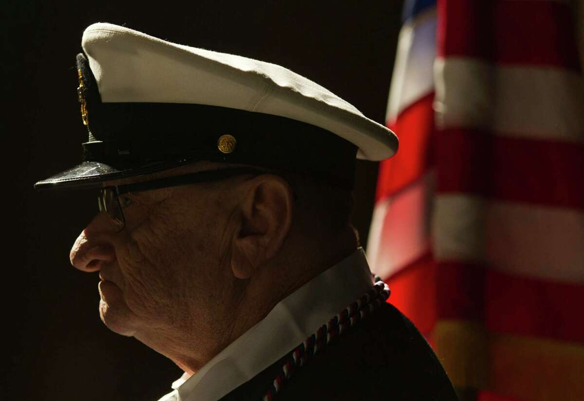Conroe High School senior Michael Sharpe, 67, is seen in his Navy uniform before graduating from Conroe High School during Conroe ISD's mid-year commencement ceremony at Conroe High School Thursday, Dec. 15, 2016, in Conroe. Sharpe left high school at 17 and joined the Navy two years later to avoid being drafted into the Army during the Vietnam War. He retired after 22 years and worked for the U.S. Postal Service following his military career.