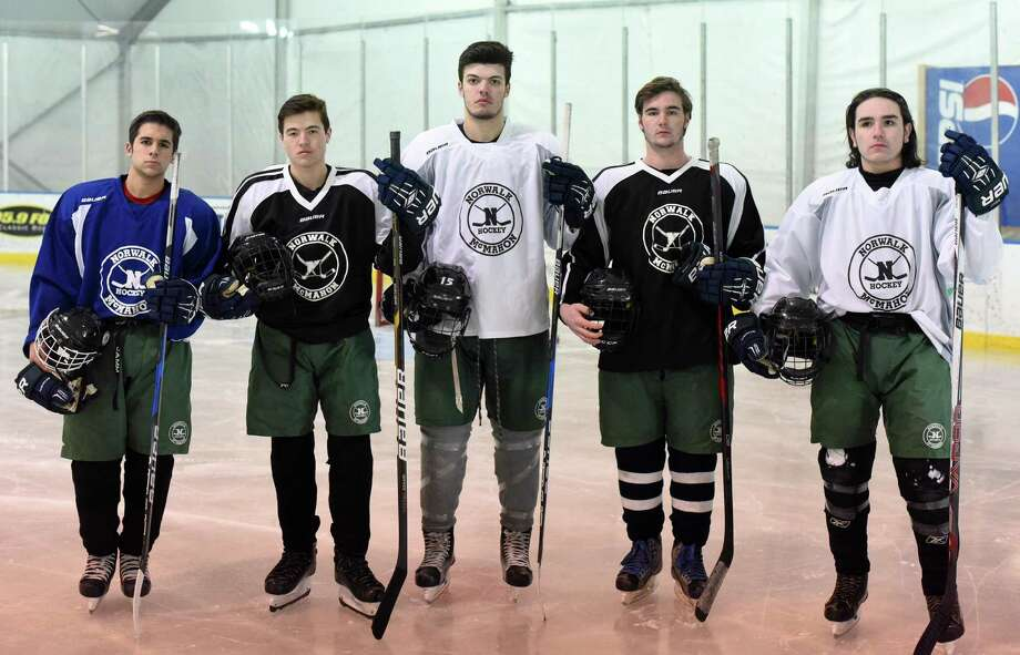 Norwalk-McMahon co-op boys ice hockey captains for the new season includes, from left, Dylan Persons, Derek Lue, Kevin Remson, Will Haskell and Patrick Auz. Photo: John Nash / Hearst Connecticut Media / Norwalk Hour