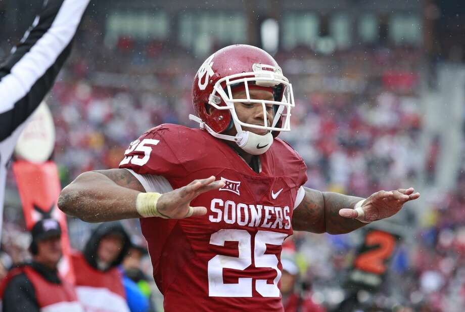 NORMAN, OK - DECEMBER 3: Running back Joe Mixon #25 of the Oklahoma Sooners celebrates a touchdown against the Oklahoma State Cowboys December 3, 2016 at Gaylord Family-Oklahoma Memorial Stadium in Norman, Oklahoma. Oklahoma defeated Oklahoma State 38-20 to become Big XII champions. (Photo by Brett Deering/Getty Images) Photo: Brett Deering/Getty Images