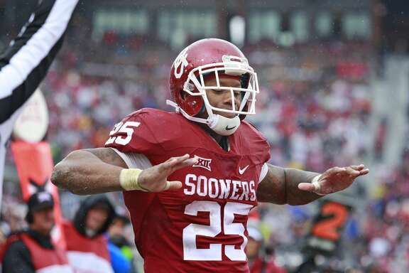 NORMAN, OK - DECEMBER 3: Running back Joe Mixon #25 of the Oklahoma Sooners celebrates a touchdown against the Oklahoma State Cowboys December 3, 2016 at Gaylord Family-Oklahoma Memorial Stadium in Norman, Oklahoma. Oklahoma defeated Oklahoma State 38-20 to become Big XII champions. (Photo by Brett Deering/Getty Images)