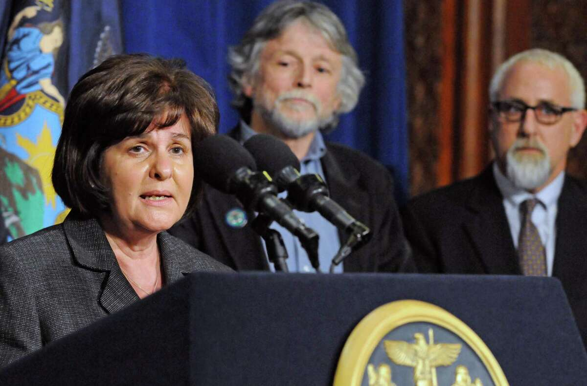 New York State Senator Kathy Marchione, left, speaks as Hoosick Falls Mayor Dave Borge, center, and school superintendent Ken Facin listen about state action on the Hoosick Falls water pollution during a press conference following a meeting with Gov. Andrew Cuomo at the Capitol on Wednesday Jan. 27, 2016 in Albany, N.Y. (Michael P. Farrell/Times Union)