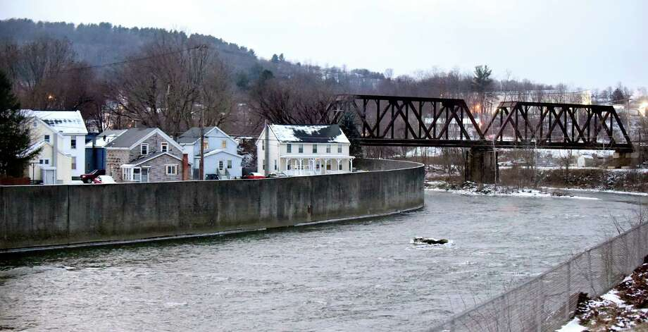 The Hoosic River flows through the village where PFOA contamination is in the water system on Thursday, Jan. 14, 2016, in Hoosick Falls, N.Y. (Cindy Schultz / Times Union) Photo: Cindy Schultz / 10035003A