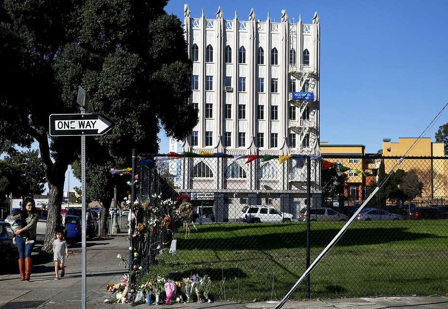 Pedestrians walk past a large unused lot on 31st St. on International Blvd. near Fruitvale Ave. Dec. 16, 2016 in Oakland, Calif. Photo: Leah Millis, The Chronicle