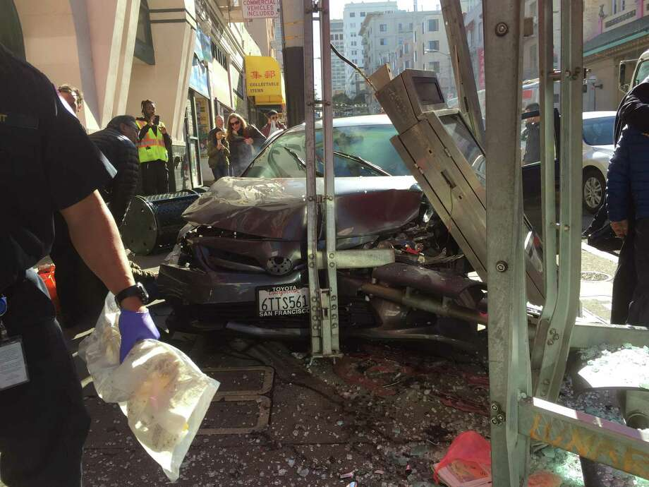 Ten people where injured Friday when this out-of-control car jumped a curb and crashed into a Muni bus shelter on Sacramento Street near Clay Street. Photo: Luong Nu / Courtesy Of Luong Nu