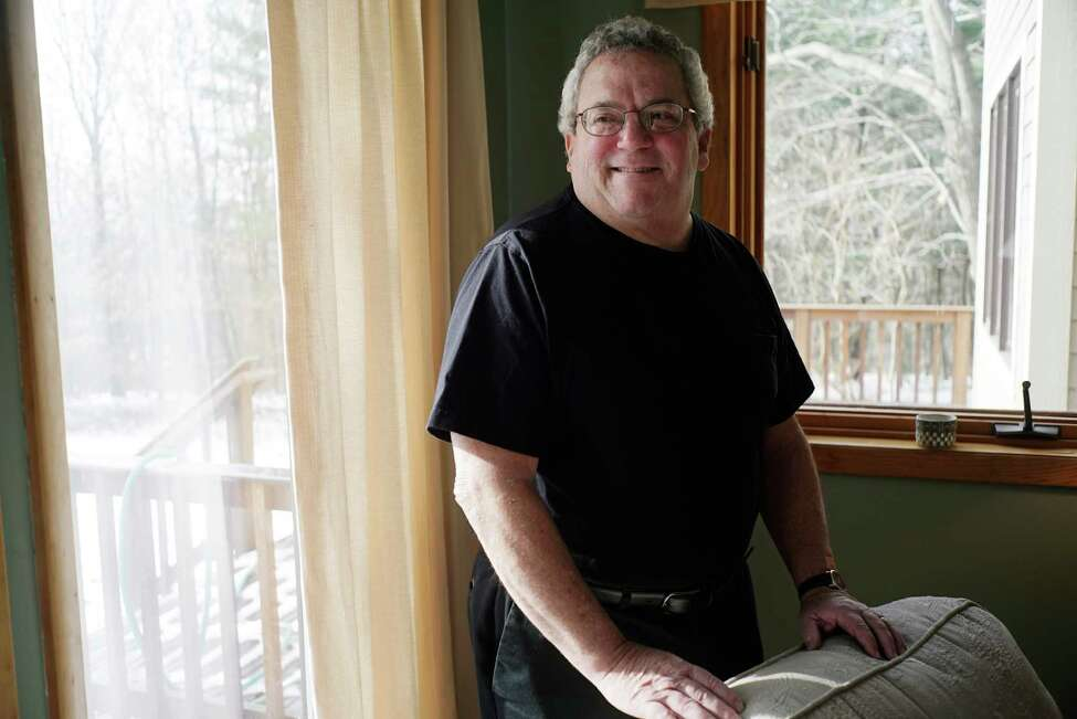 Jonathan Gradess poses for a photo at his home on Tuesday, Dec. 13, 2016, in Poestenkill, N.Y. (Paul Buckowski / Times Union)