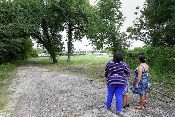 Theresa Cavin, from left, her daughter Hannah Quintanilla, 7, her mother Valerie Gonzales and her son Austin, 9, look at the White Oak Music Hall from their street, Saturday, Aug. 13, 2016, in Houston. The family lives across the the bayou from the concert venue and complains about the loud outdoor concerts. ( Jon Shapley / Houston Chronicle )