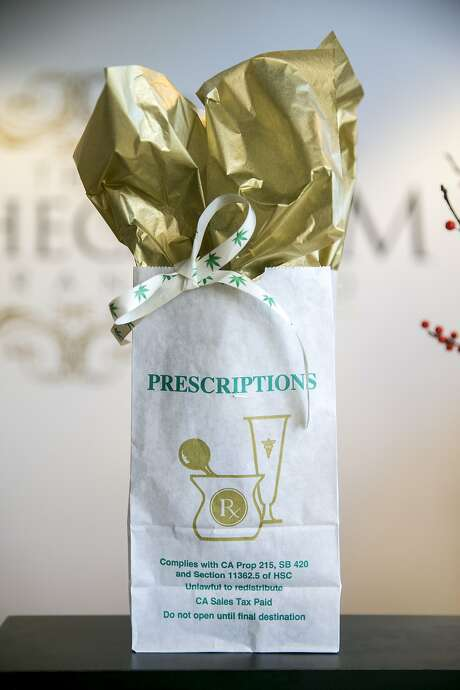 A prescription is ready for pickup at the Apothecarium in San Francis co. Co-founder Ryan Hudson says the shop is well prepared to switch to a traditional retail model. Photo: Santiago Mejia, The Chronicle