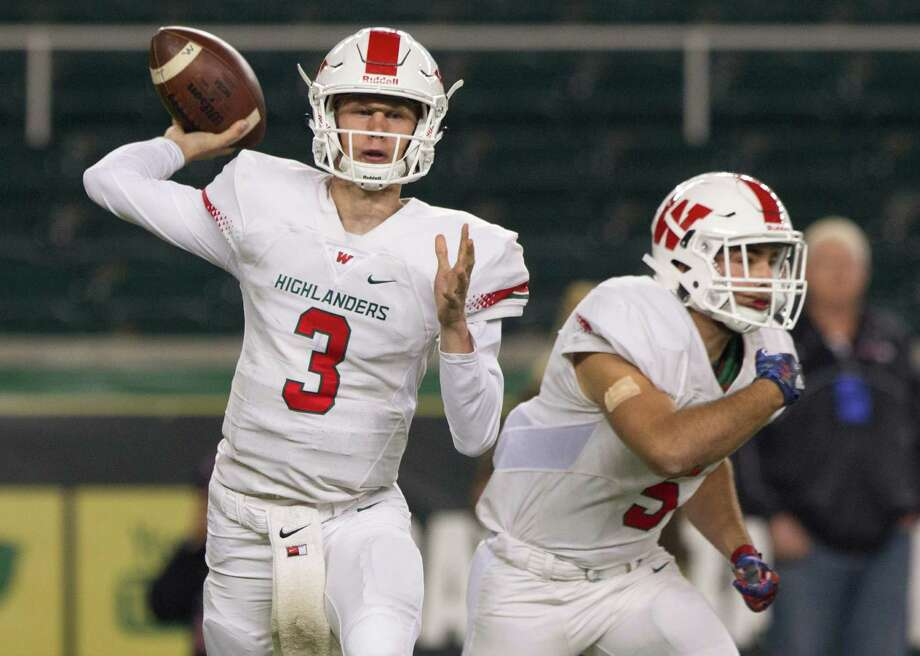 The Woodlands quarterback Eric Schmid (3) drops back to pass during the first quarter of a Class 6A Division I regional semifinal game at McLane Stadium Saturday, Nov. 26, 2016, in Waco. Schmid finished the first half 8-for-12 for 218 yards, two touchdowns and an interception, while rushing for 64 yards and a touchdown. Photo: Jason Fochtman, Staff Photographer / Houston Chronicle