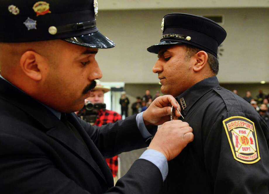 At shaven son's swearing-in, Bridgeport firefighter explains