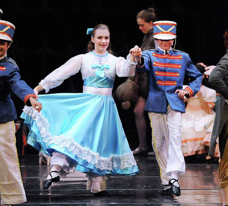 "At left, Anna Saggese, 14, of Greenwich, dances as Clara during the Connecticut Ballet's dress rehearsal for the ""The Nutcracker"" at the Palace Theatre in Stamford on Friday night. A performance of the holiday favorite will take place at the Palace on Saturday 2 and 6 p.m. and Sunday at 1 and 5 p.m. Photo: Bob Luckey Jr. / Hearst Connecticut Media / Greenwich Time"