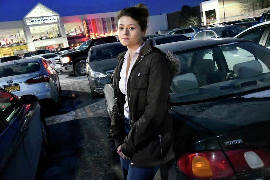 Cydney Palmatier, 20, a server at Ruby Tuesday's, stands by her car on Friday, Dec. 16, 2016, at Crossgates Mall in Guilderland, N.Y. All the Christmas gifts she bought with waitressing money for her family were stolen on Sunday when a thief broke a window and stole the presents. (Cindy Schultz / Times Union) Photo: Cindy Schultz / Albany Times Union