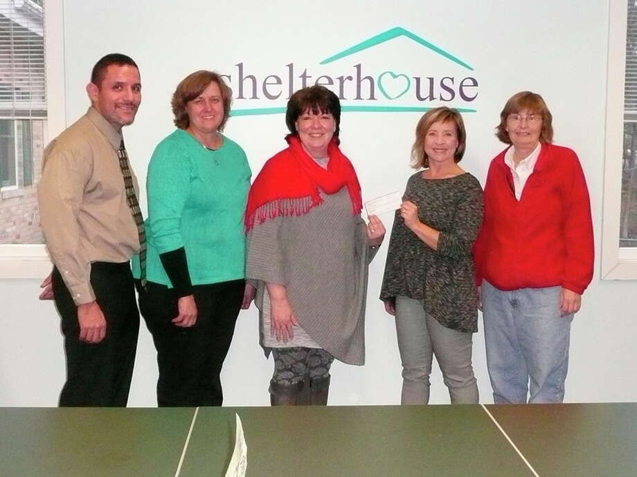 Photo Provided From left, Michael Spencer, president, Judy V. Spencer Fund; Robin Greiner, Shelterhouse shelter services coordinator; Janine Ouderkirk, Shelterhouse executive director; Shelley Park Cluff, SOS Animal Rescue vice president; and Joann Taylor, SOS Animal Rescue president, participate in a recent check presentation at Shelterhouse.