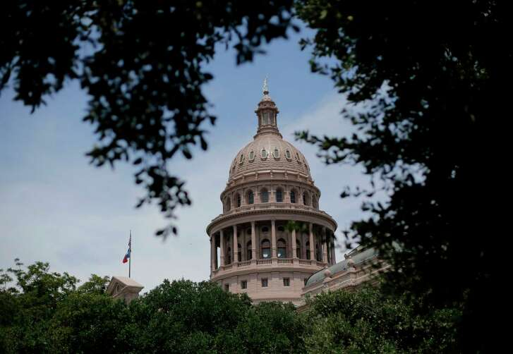 The dome of the Texas State Capital is seen through trees in Austin, Texas.  (AP File Photo)