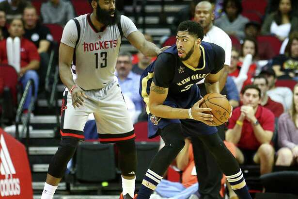 Houston Rockets guard James Harden (13) guards New Orleans Pelicans forward Anthony Davis (23) during the second quarter of an NBA game, at the Toyota Center, Friday, Dec. 16, 2016, in Houston.