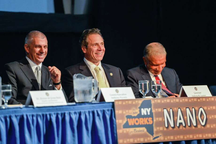 Gov. Andrew M. Cuomo, center, announces Nano Utica, a $1.5 billion public-private investment that will make the Mohawk Valley a major hub of nano tech research, on Oct. 10, 2013, in Utica, N.Y. (Office of the Governor)