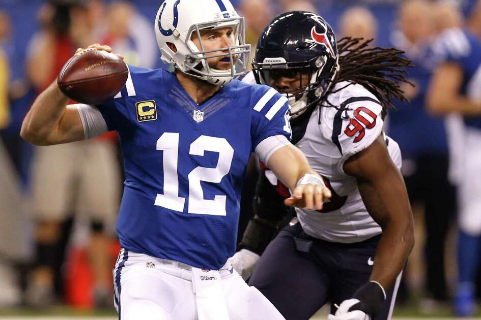 Texans defensive end Jadeveon Clowney, right, pressures Colts quarterback Andrew Luck into throwing an incompletion last Sunday.