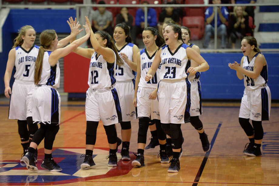 Midland Christian girls basketball players celebrate a win against Brownfield on Friday, Dec. 16, 2016, at McGraw Event Center. James Durbin/Reporter-Telegram Photo: James Durbin