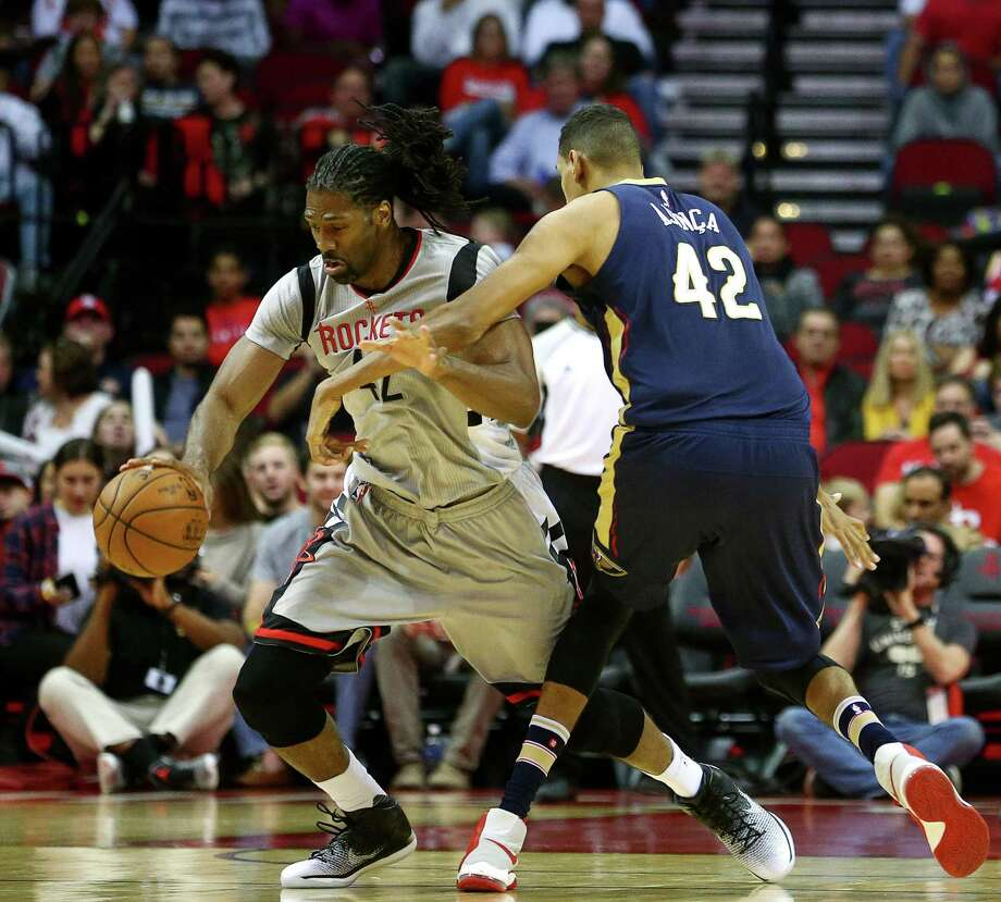 Houston Rockets center Nene Hilario (42) is fouled by New Orleans Pelicans center Alexis Ajinca (42) during the first quarter of an NBA game, at the Toyota Center, Friday, Dec. 16, 2016, in Houston. Photo: Jon Shapley, Houston Chronicle / © 2015  Houston Chronicle