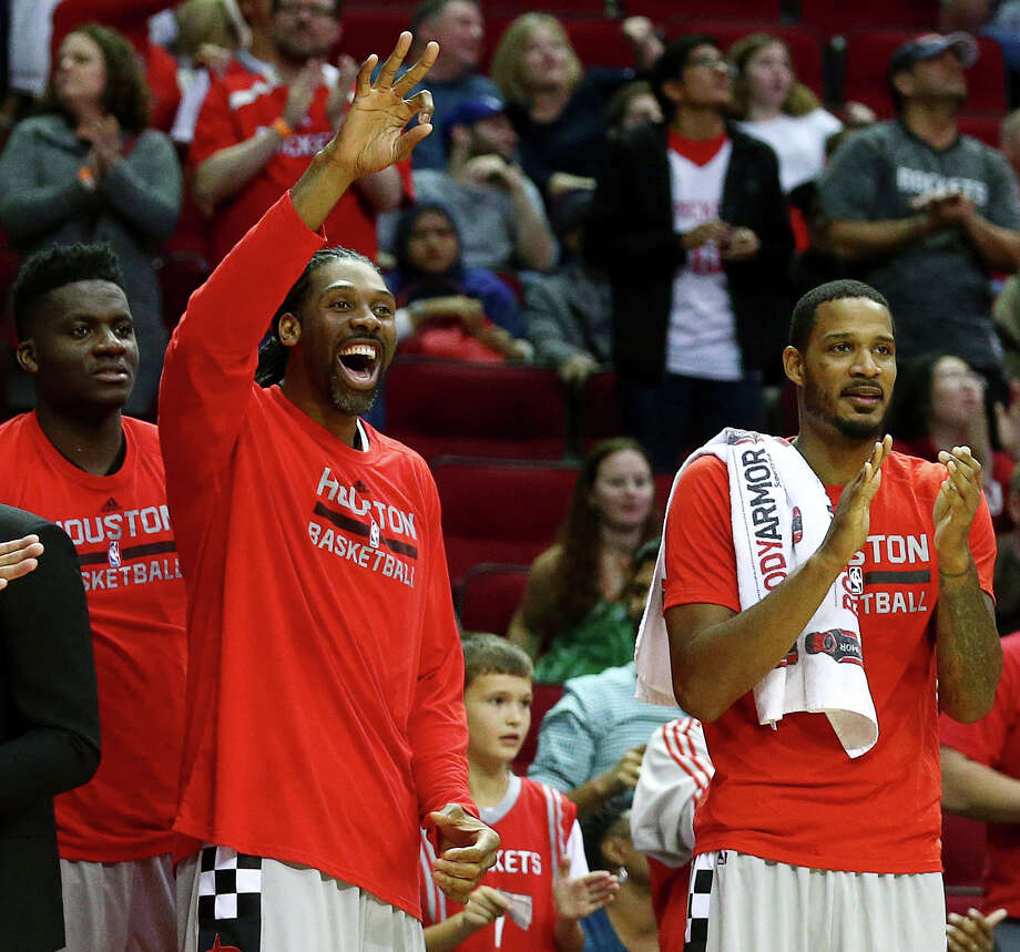 Houston Rockets forward Trevor Ariza (1), from right, center Nene Hilario (42) and center Clint Capela (15) celebrate during the fourth quarter of an NBA game, at the Toyota Center, Friday, Dec. 16, 2016, in Houston. Photo: Jon Shapley, Houston Chronicle / © 2015  Houston Chronicle