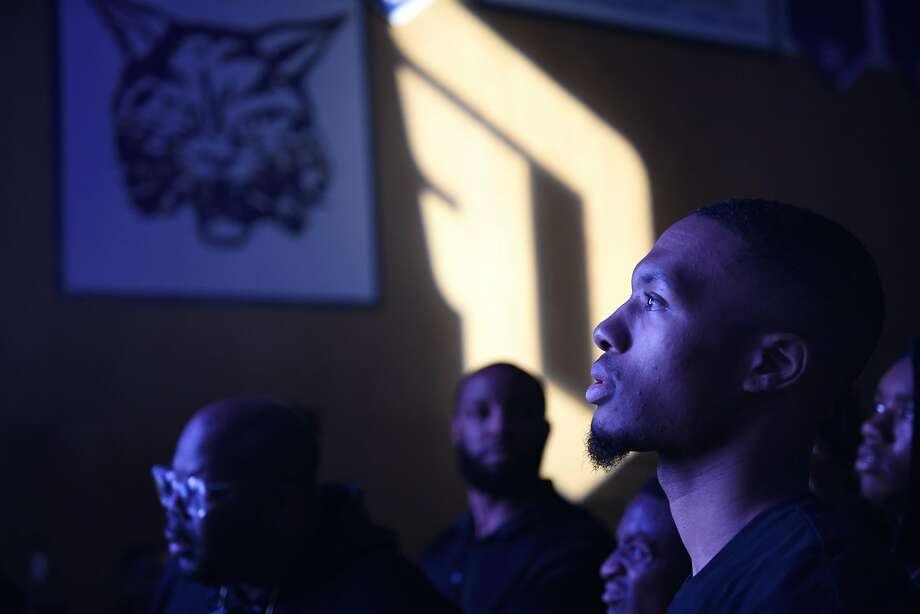 Damian Lillard of the Portland Trail Blazers watches the star-studded event at the Oakland High School gymnasium. Photo: Michael Short, Special To The Chronicle