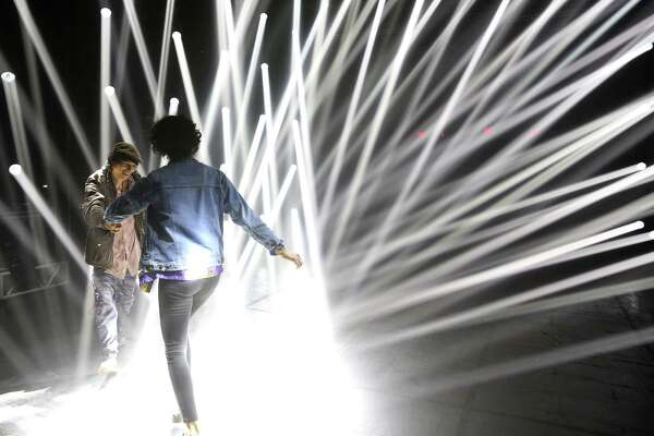 Rock Wardell and Shalma Anderson dance in light rays in an art installation at Day for Night festival opening night Friday, Dec. 16, 2016, in Houston.