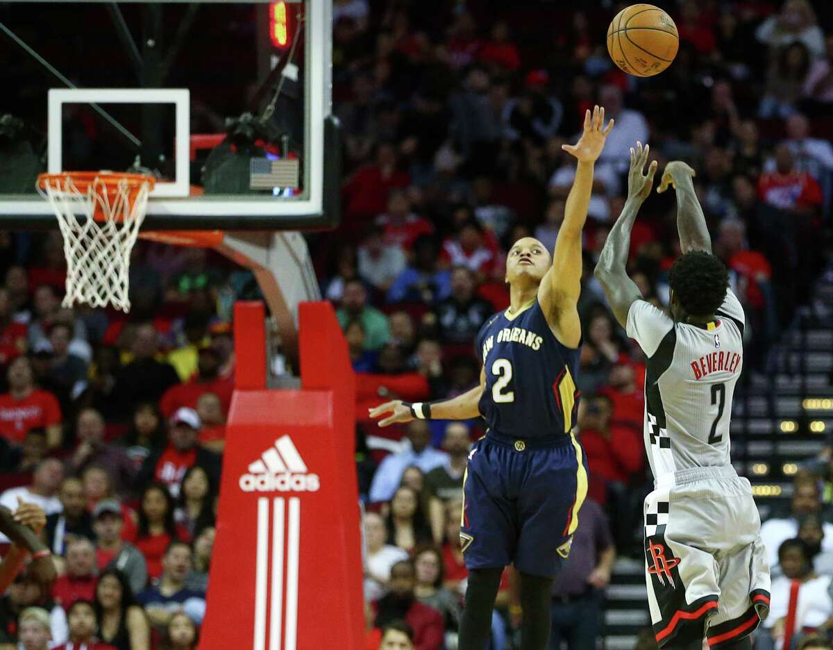 Houston Rockets guard Patrick Beverley (2) shoots over New Orleans Pelicans guard Tim Frazier (2) during the fourth quarter of an NBA game, at the Toyota Center, Friday, Dec. 16, 2016, in Houston.