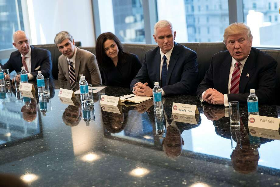 NEW YORK, NY - DECEMBER 14: (L to R) Jeff Bezos, chief executive officer of Amazon, Larry Page, chief executive officer of Alphabet Inc. (parent company of Google), Sheryl Sandberg, chief operating officer of Facebook, Vice President-elect Mike Pence listen as President-elect Donald Trump speaks during a meeting of technology executives at Trump Tower, December 14, 2016 in New York City. This is the first major meeting between President-elect Trump and technology industry leaders. (Photo by Drew Angerer/Getty Images) Photo: Drew Angerer, Getty Images