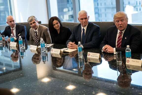 NEW YORK, NY - DECEMBER 14: (L to R) Jeff Bezos, chief executive officer of Amazon, Larry Page, chief executive officer of Alphabet Inc. (parent company of Google), Sheryl Sandberg, chief operating officer of Facebook, Vice President-elect Mike Pence listen as President-elect Donald Trump speaks during a meeting of technology executives at Trump Tower, December 14, 2016 in New York City. This is the first major meeting between President-elect Trump and technology industry leaders. (Photo by Drew Angerer/Getty Images)