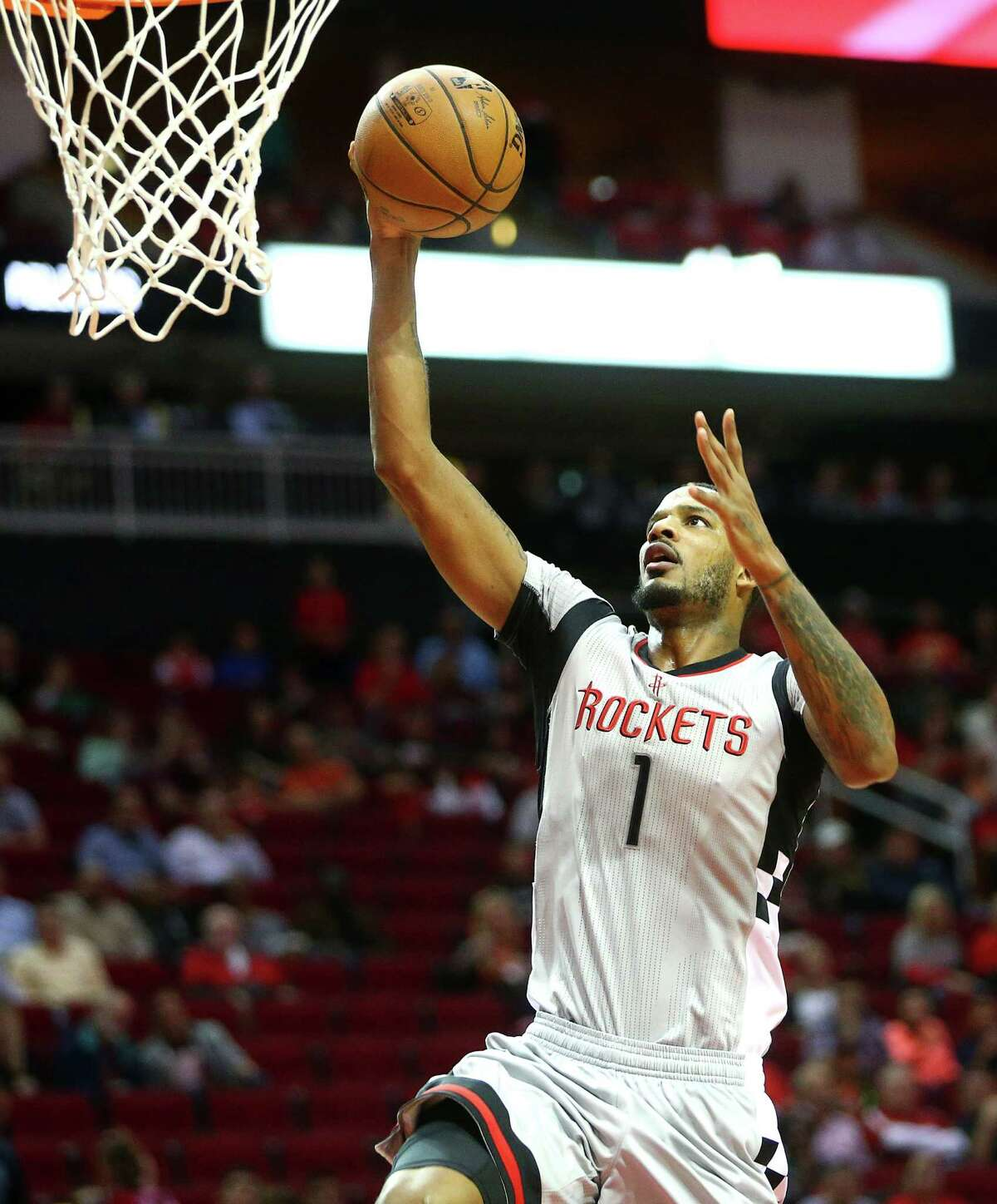 Houston Rockets forward Trevor Ariza (1) scores during the first quarter of an NBA game, at the Toyota Center, Friday, Dec. 16, 2016, in Houston.