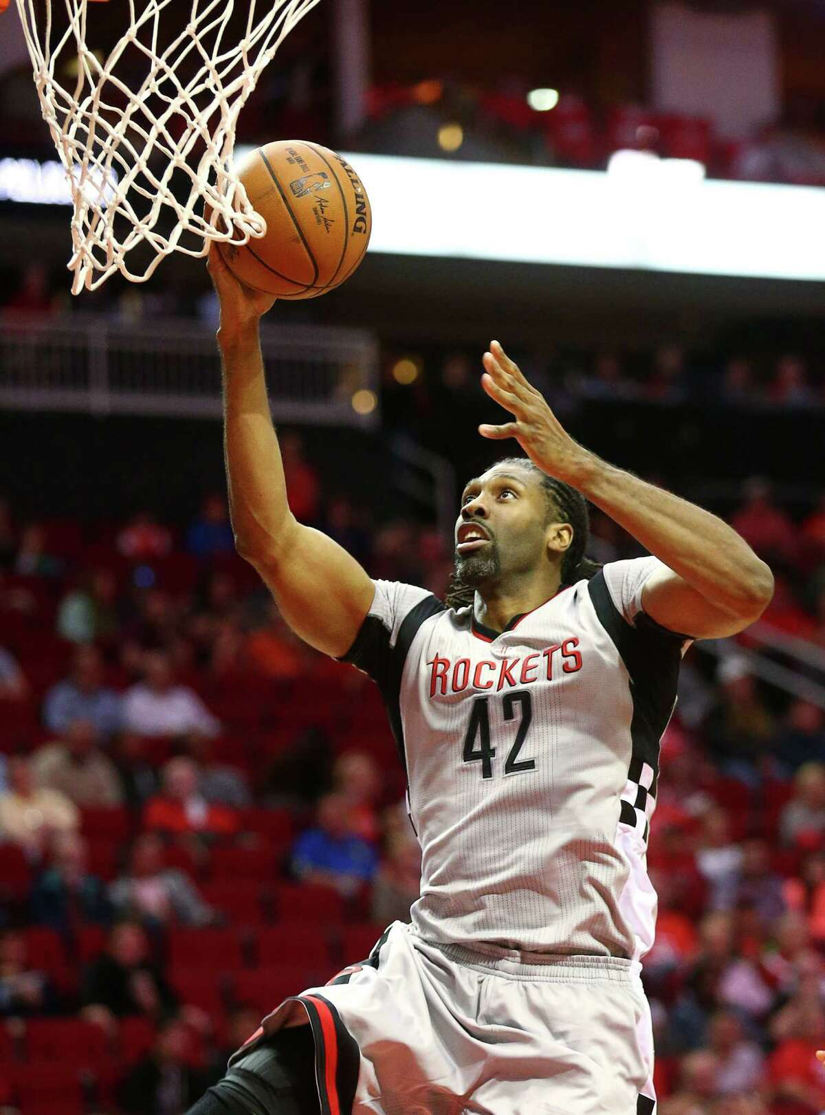 Houston Rockets center Nene Hilario (42) scores during the first quarter of an NBA game, at the Toyota Center, Friday, Dec. 16, 2016, in Houston.