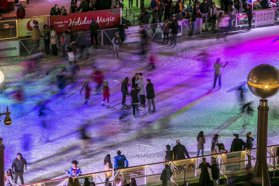 Center: Bryan Verduzco embraces Brittney Adams after Verduzco proposed to her in the middle of the Union Square ice rink on Friday, Dec. 16, 2016 in San Francisco, Calif. Adams said yes. Photo: Santiago Mejia, The Chronicle