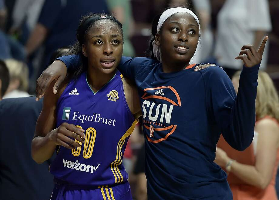 FILE - In this May 26, 2016, file photo, sisters Los Angeles Sparks' Nneka Ogwumike, left, and Connecticut Sun's Chiney Ogwumike, right, walk off the court together at the end of a WNBA basketball game between the their teams in Uncasville, Conn. Nneka Ogwumike earned the inaugural Associated Press WNBA Player of the Year on Tuesday, Sept. 20, 2016. Chiney Ogwumike earned comeback player of the year honors. (AP Photo/Jessica Hill, File) Photo: Jessica Hill, Associated Press