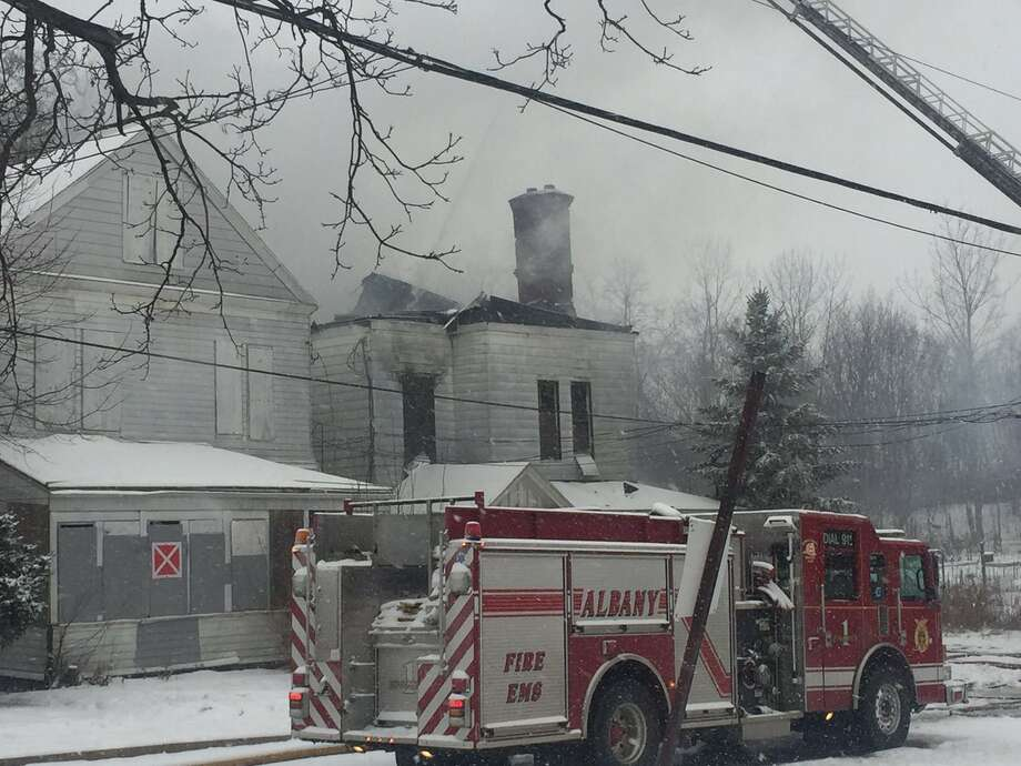 Site of a morning fire on Saturday, Dec. 17, 2016 at 15 Leonard Place, Delmar, NY. (Robert Downen/Times Union)