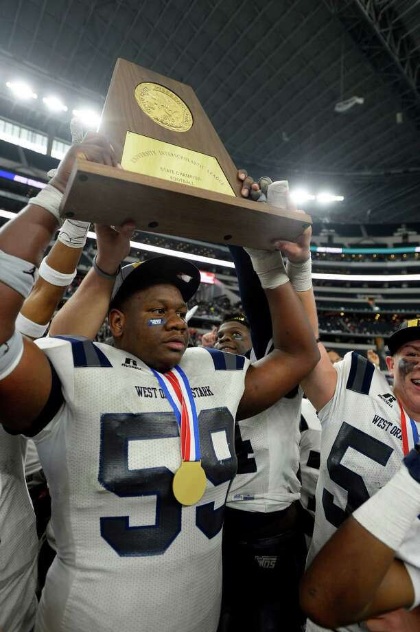 West Orange-Stark's Morris Joseph hoists the state championship trophy after beating Sweetwater in the Class 4A-Division II state final at AT&T Stadium in Arlington on Friday. Photo taken Friday 12/16/16 Ryan Pelham/The Enterprise Photo: Ryan Pelham / ©2016 The Beaumont Enterprise/Ryan Pelham