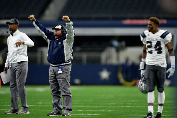 West Orange-Stark coach Cornel Thompson celebrates after a touchdown during the second quarter of the Class 4A-Division II state final against Sweetwater at AT&T Stadium in Arlington on Friday. Photo taken Friday 12/16/16 Ryan Pelham/The Enterprise