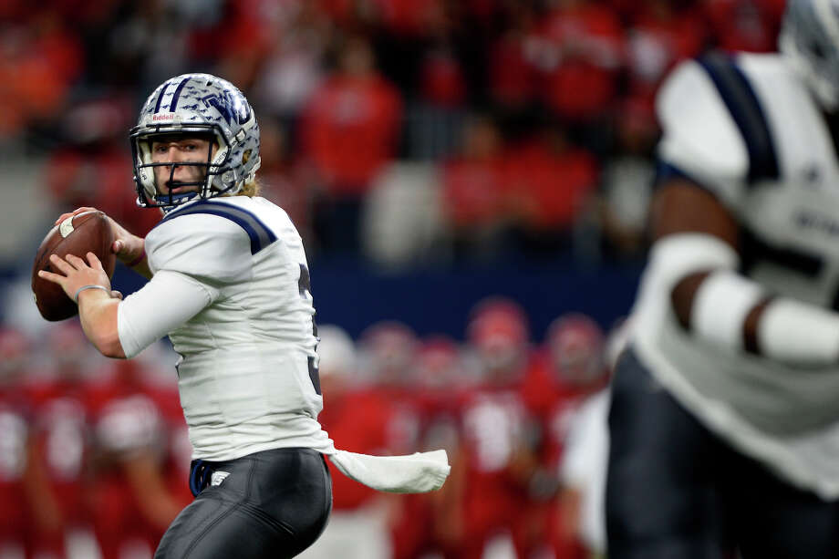 West Orange-Stark quarterback Jack Dallas looks to throw during the first quarter of the Class 4A-Division II state final against Sweetwater at AT&T Stadium in Dallas on Friday. Photo taken Friday 12/16/16 Ryan Pelham/The Enterprise Photo: Ryan Pelham / ©2016 The Beaumont Enterprise/Ryan Pelham