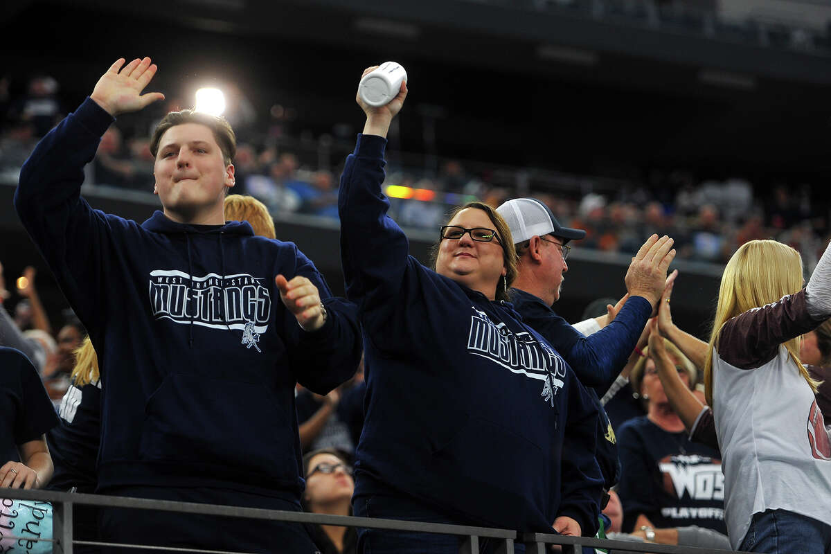 West Orange-Stark fans cheer as they take on Sweetwater in the Class 4A-Division II state final at AT&T Stadium in Arlington on Friday. Photo taken Friday 12/16/16 Ryan Pelham/The Enterprise